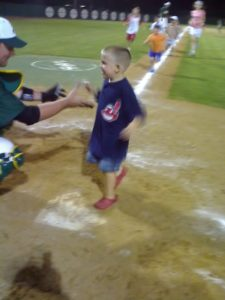 Lewisville Lizards post-game fan running bases